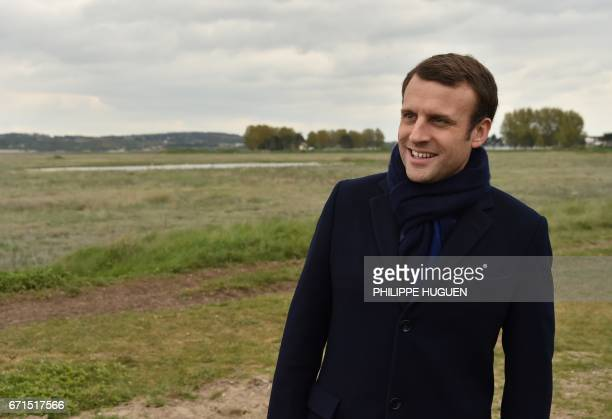 French presidential election candidate for the En Marche movement Emmanuel Macron looks on as he poses for the photograph on April 22 in Le Touquet...
