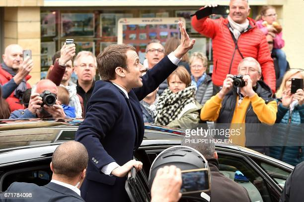 TOPSHOT French presidential election candidate for the En Marche movement Emmanuel Macron waves at supporters after voting in Le Touquet northern...