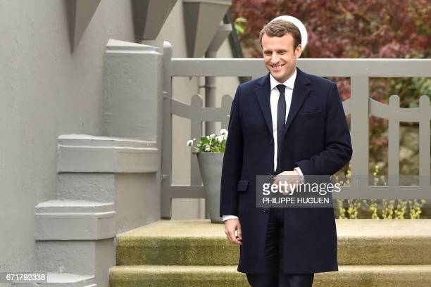 French presidential election candidate for the En Marche movement Emmanuel Macron leaves his house in Le Touquet northern France on April 23 during...