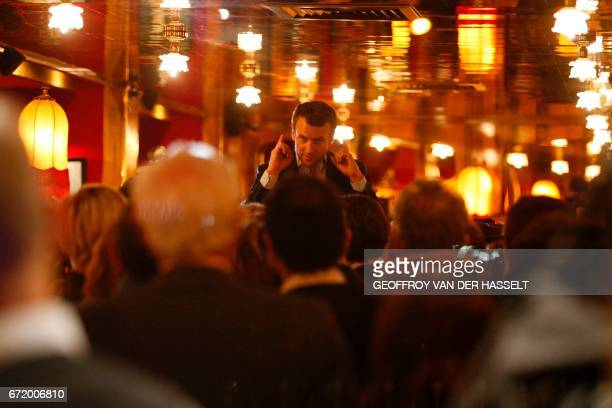 TOPSHOT French presidential election candidate for the En Marche movement Emmanuel Macron meets some of his supporters at La Rotonde restaurant in...