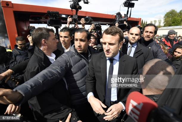TOPSHOT French presidential election candidate for the En Marche movement Emmanuel Macron arrives outside Whirlpool factory outside the Amiens...