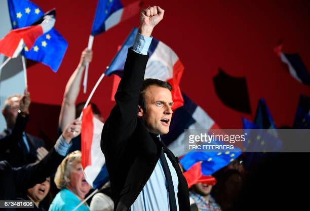 French presidential election candidate for the En Marche movement Emmanuel Macron reacts as he gives a speech during a meeting in Arras on April 26...