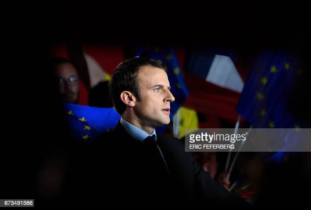 TOPSHOT French presidential election candidate for the En Marche movement Emmanuel Macron gives a speech during a meeting in Arras on April 26 ahead...