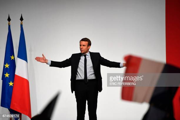 French presidential election candidate for the En Marche movement Emmanuel Macron gestures during his speech to supporters at the Angerlarde hall in...