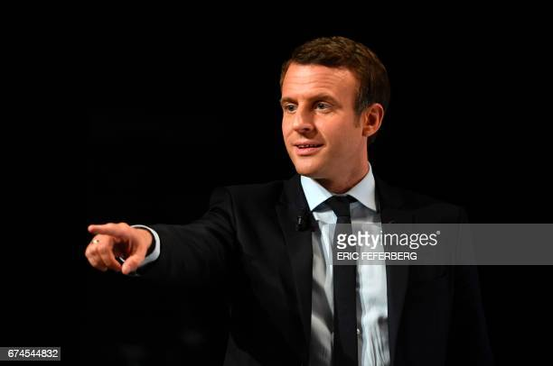 French presidential election candidate for the En Marche movement Emmanuel Macron gestures as he addresses supporters at the Angerlarde hall in...