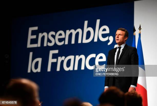 French presidential election candidate for the En Marche movement Emmanuel Macron addresses supporters at the Angerlarde hall in Chatellerault...