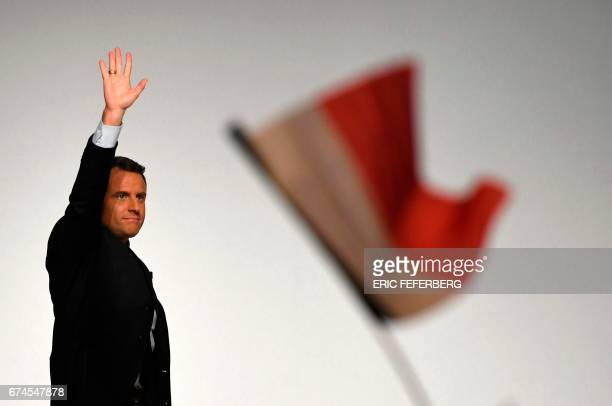 French presidential election candidate for the En Marche movement Emmanuel Macron waves to supporters at the Angerlarde hall in Chatellerault western...