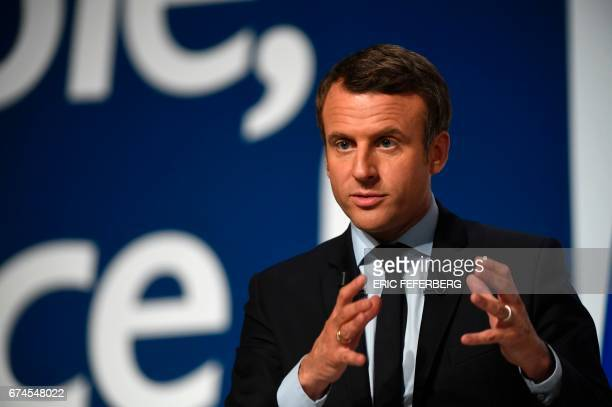 French presidential election candidate for the En Marche movement Emmanuel Macron gestures as he speaks to supporters at the Angerlarde hall in...