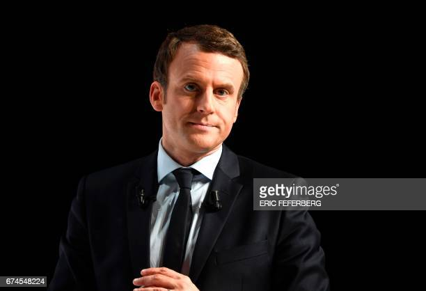 French presidential election candidate for the En Marche movement Emmanuel Macron looks on during his speech at the Angerlarde hall in Chatellerault...