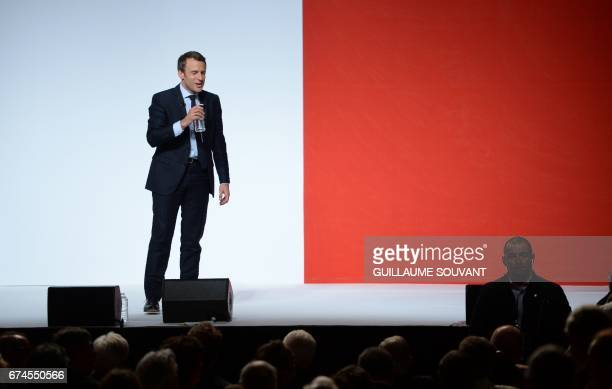 French presidential election candidate for the En Marche movement Emmanuel Macron gestures as he gives a speech on April 28 2017 during a meeting...