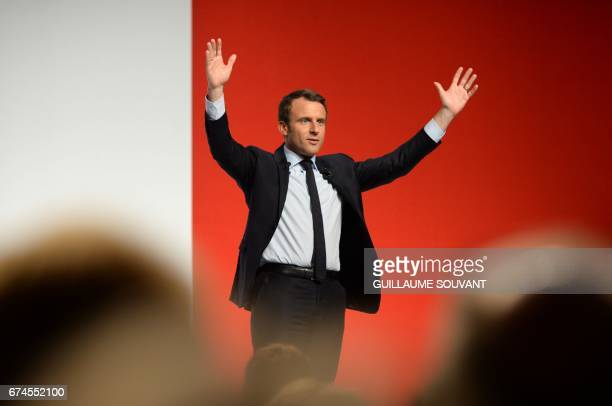 French presidential election candidate for the En Marche movement Emmanuel Macron gestures on April 28 2017 during a meeting ahead of the second and...