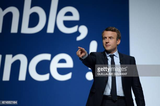 French presidential election candidate for the En Marche movement Emmanuel Macron answers questions during a meeting ahead of the second and final...