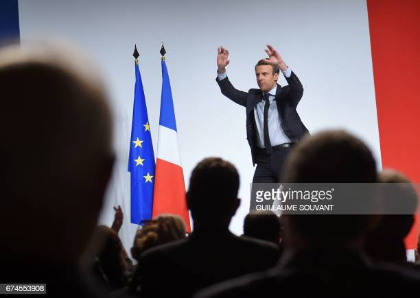 French presidential election candidate for the En Marche movement Emmanuel Macron gestures as he speaks to supporters ahead of the second and final...