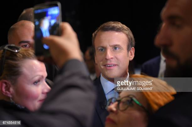 French presidential election candidate for the En Marche movement Emmanuel Macron has his photo taken with supporters following his speech ahead of...