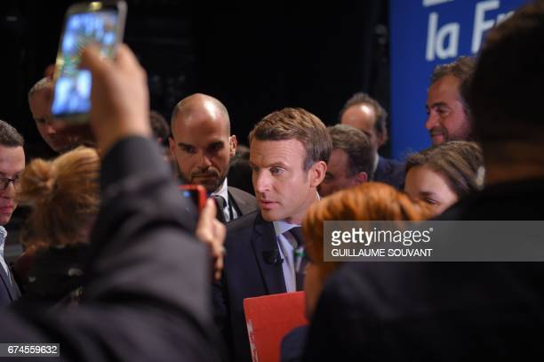 French presidential election candidate for the En Marche movement Emmanuel Macron speaks with supporters following his speech ahead of the second and...