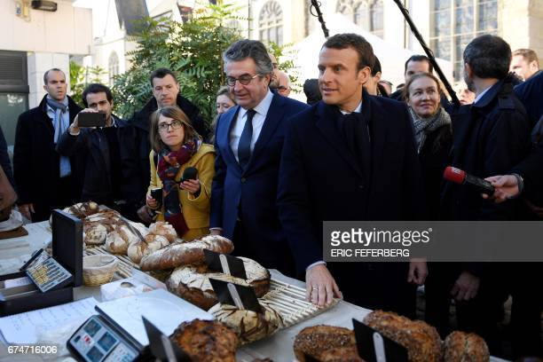 French presidential election candidate for the En Marche movement Emmanuel Macron flanked by mayor of Poitiers Alain Claeys and his spokesperson...