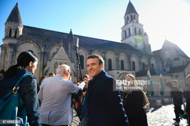 French presidential election candidate for the En Marche movement Emmanuel Macron flanked by his spokesperson Laurence Haim looks on on April 29 2017...