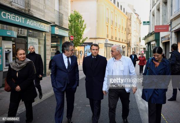 French presidential election candidate for the En Marche movement Emmanuel Macron flanked by his spokesperson Laurence Haim and Poitiers Mayor Alain...