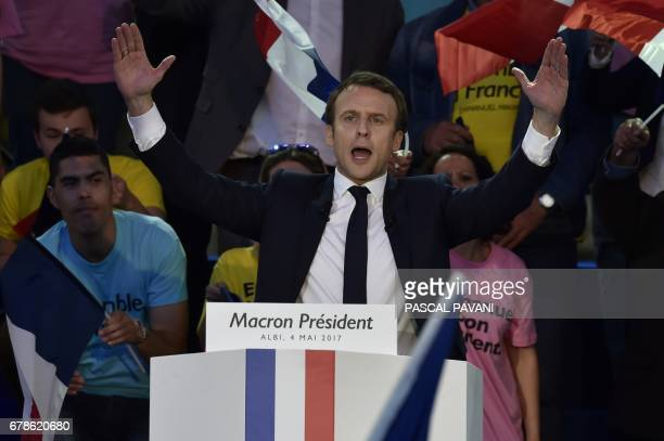 French presidential election candidate for the En Marche movement Emmanuel Macron delivers a speech during a campaign meeting at the Place du Vigan...