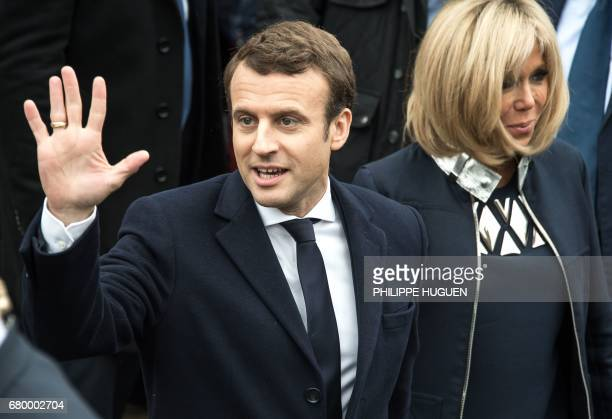 French presidential election candidate for the En Marche movement Emmanuel Macron waves to supporters next to his wife Brigitte Trogneux on May 7 in...