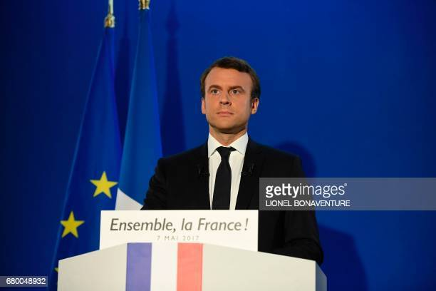 TOPSHOT French presidential election candidate for the En Marche movement Emmanuel Macron delivers a speech at his campaign headquarters in Paris on...