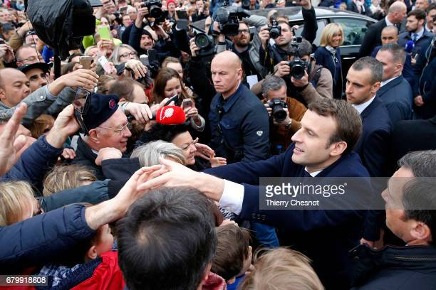 French presidential election candidate for the 'En Marche' political movement Emmanuel Macron meets his supporters as he leaves the polling station...