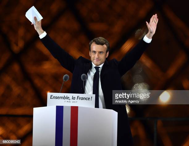 French presidential election candidate for the 'En Marche' political movement Emmanuel Macron greets after winning the 2017 French election at the...