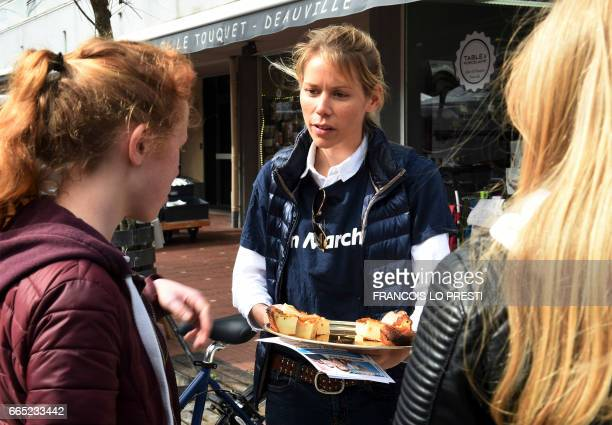French presidential election candidate for the EnMarche movement Emmanuel Macron's stepdaughter Tiphaine Auziere distributes leaflets of the 'En...