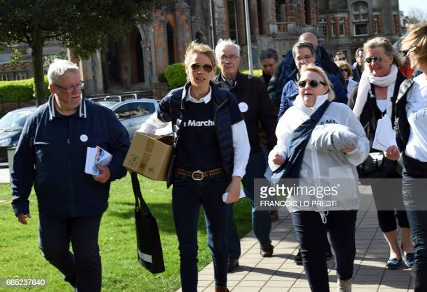 French presidential election candidate for the EnMarche movement Emmanuel Macron's stepdaughter Tiphaine Auziere prepare to distribute leaflets of...
