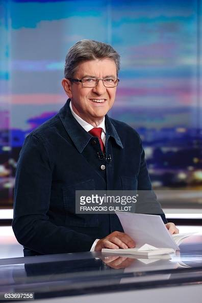 French presidential election candidate for the farleft coalition La France insoumise JeanLuc Melenchon poses prior to an interview on the evening...