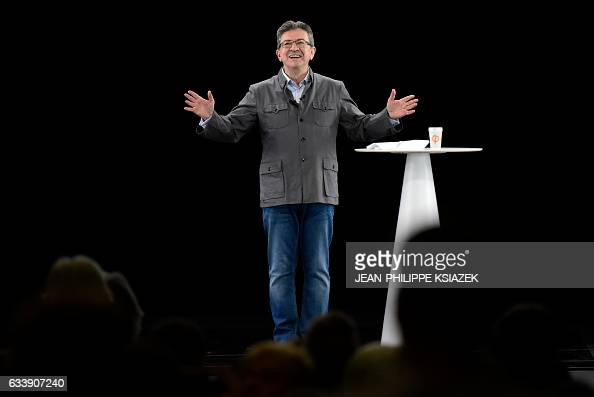 French presidential election candidate for the farleft coalition 'La France insoumise' JeanLuc Melenchon gestures as he delivers a speech during his...