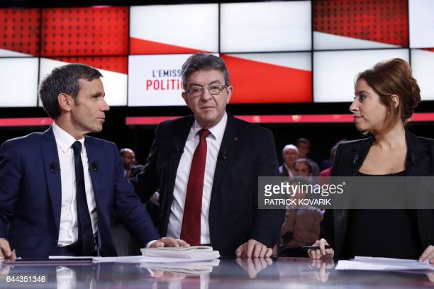 French presidential election candidate for the farleft coalition 'La France insoumise' JeanLuc Melenchon stands next to journalists and TV hosts...