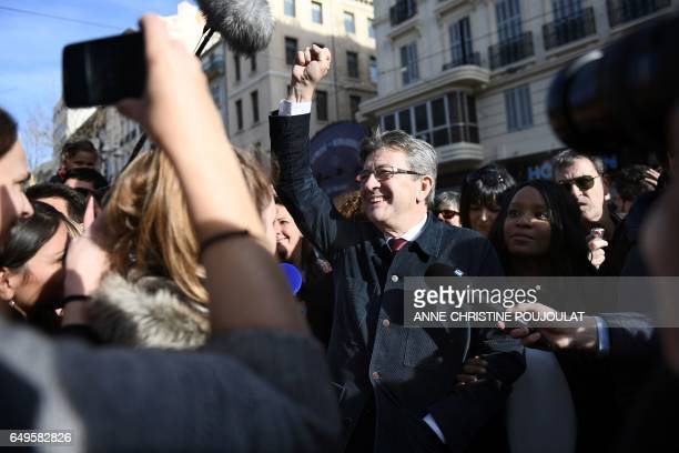 TOPSHOT French presidential election candidate for the farleft coalition 'La France insoumise' JeanLuc Melenchon gestures during a gathering as part...
