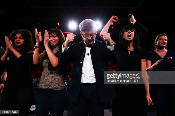 TOPSHOT French presidential election candidate for the farleft coalition 'La France insoumise' JeanLuc Melenchon gestures as he stands on stage...