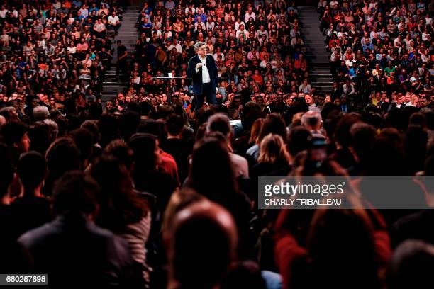 TOPSHOT French presidential election candidate for the farleft coalition 'La France insoumise' JeanLuc Melenchon gestures as he delivers a speech...