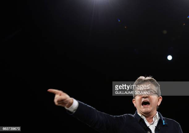 TOPSHOT French presidential election candidate for the farleft coalition La France insoumise JeanLuc Melenchon gestures as he speaks on on stage...