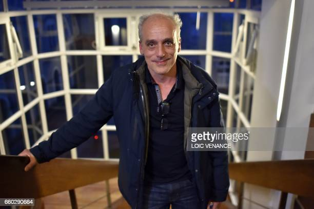 French presidential election candidate for the farleft New Anticapitalist Party Philippe Poutou poses before a campaign meeting on March 29 2017 in...