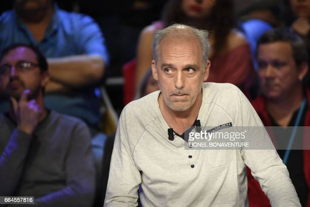 French presidential election candidate for the farleft New Anticapitalist Party Philippe Poutou looks on during a debate organised by the French...