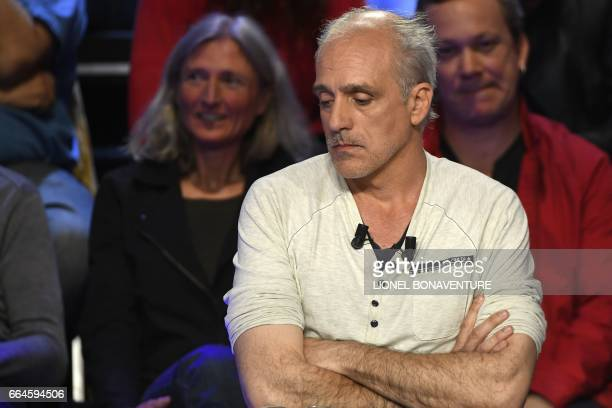 French presidential election candidate for the farleft New Anticapitalist Party Philippe Poutou reacts during a debate organised by the French...