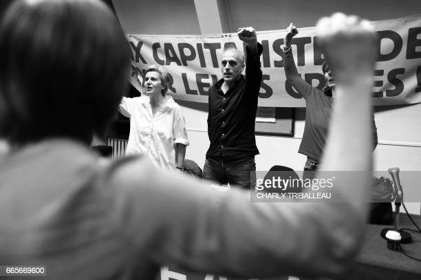 French presidential election candidate for the farleft New Anticapitalist Party Philippe Poutou gestures as he delivers a speech during a campaign...