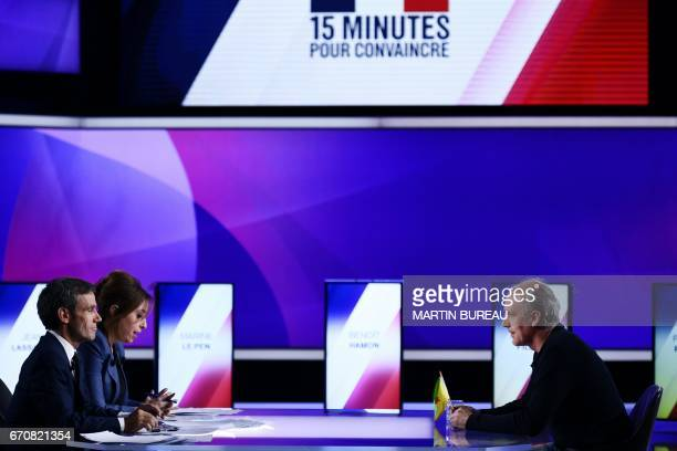 French presidential election candidate for the farleft New Anticapitalist Party Philippe Poutou speaks with French journalists and television hosts...
