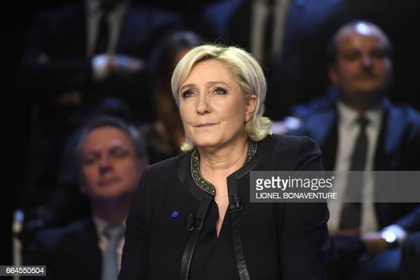 French presidential election candidate for the farright Front National party Marine Le Pen attends a debate organised by the French private TV...