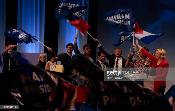 French presidential election candidate for the farright Front National party Marine Le Pen acknowledges the audience at the end of a campaign meeting...