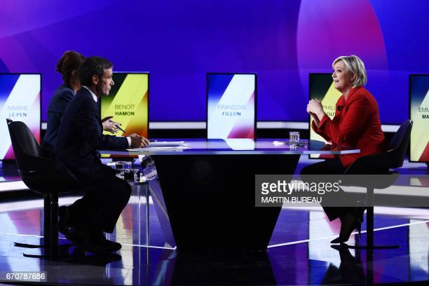 French presidential election candidate for the farright Front National party Marine Le Pen speaks with French journalists and television hosts David...