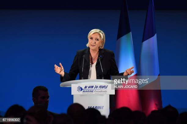 French presidential election candidate for the farright Front National party Marine Le Pen delivers a speech in HeninBeaumont on April 23 after the...