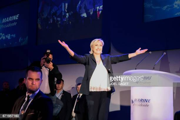 TOPSHOT French presidential election candidate for the farright Front National party Marine Le Pen delivers a speech in HeninBeaumont on April 23...