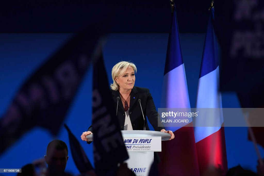 TOPSHOT - French presidential election candidate for the far-right Front National (FN) party Marine Le Pen delivers a speech in Henin-Beaumont, on April 23, 2017, after the first round of the Presidential election. /