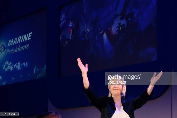 TOPSHOT CORRECTION French presidential election candidate for the farright Front National party Marine Le Pen delivers a speech in HeninBeaumont on...