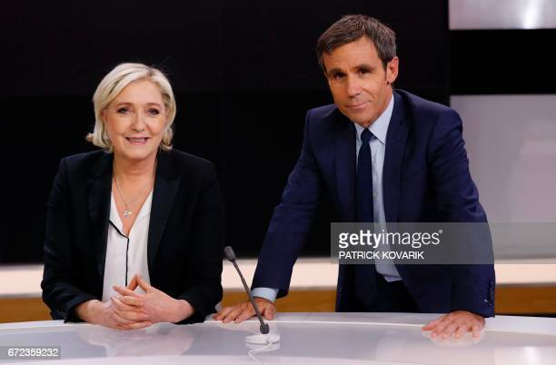 French presidential election candidate for the farright Front National party Marine Le Pen poses with French journalist David Pujadas before an...