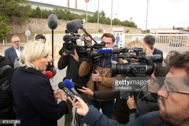 French presidential election candidate for the farright Front National party Marine Le Pen speaks to journalists in front of the Alteo aluminium...